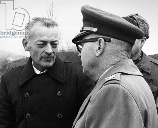 LLOYD M. BUCHER (1927-2004) American naval officer. Bucher (left), the commander of the U.S.S. 'Pueblo,' speaking with a colonel of the United Nations Command after crossing the bridge into South Korea at Panmunjom, 22 December 1968, following the release of himself and his crew by North Korea, where they had been held captive for the previous 11 months.