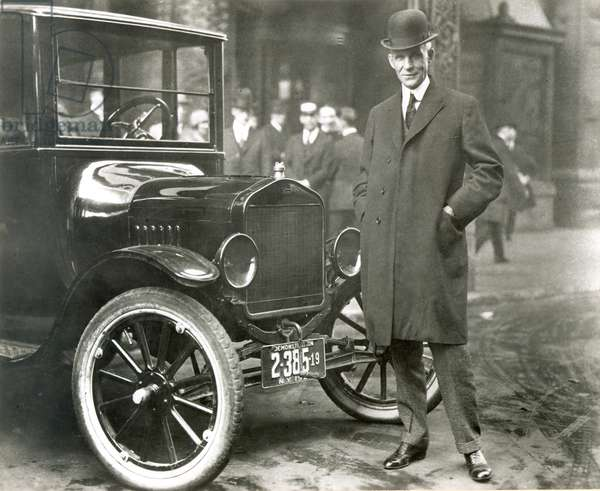 HENRY FORD (1863-1947) American automobile manufacturer. Photographed with one of his Model T automobiles, c.1920.