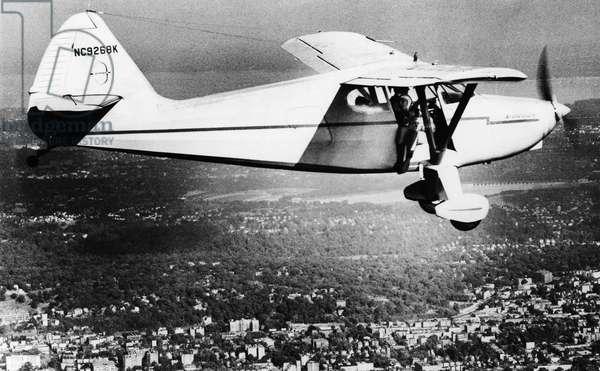 BERNARR MACFADDEN (1868-1955). American physical culturist. Macfadden prepared to jump off the plane and parachute over the Hudson River, 26 August 1951.
