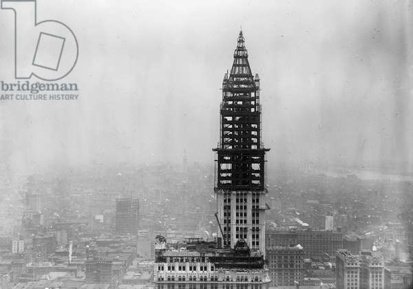 WOOLWORTH BUILDING, 1912 Tower construction for the Woolworth Building on lower Broadway, New York City, which was completed in April 1913. On the right is the Municipal Building, also under construction. Photograph, c.1912.