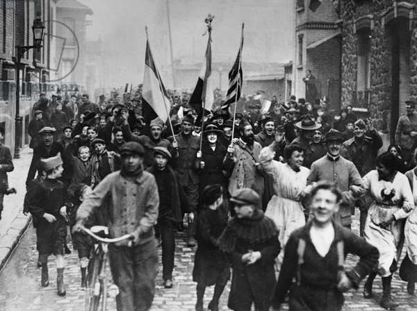 WORLD WAR I: ARMISTICE, 1918 Parisians and Allied troops celebrating the signing of the armistice in the streets of Paris at the end of World War I, 11 November 1918.
