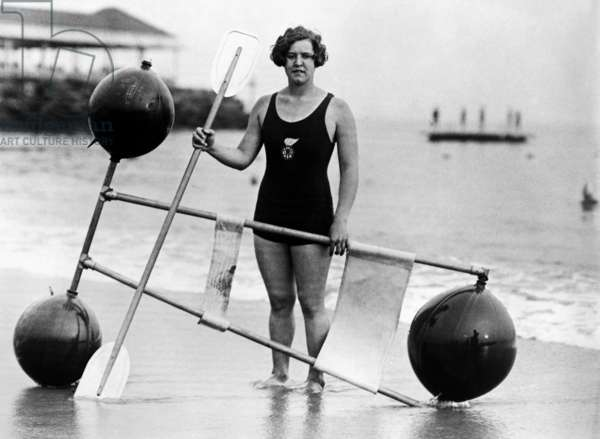 GERTRUDE EDERLE (1906-2003) American swimmer. Photographed with a paddling device, 1924.