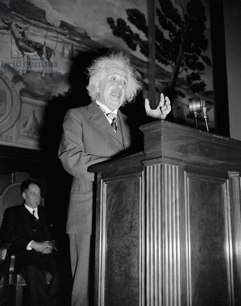 ALBERT EINSTEIN  (1879-1955). American (German-born) theoretical physicist. Photographed giving a lecture, c.1940.
