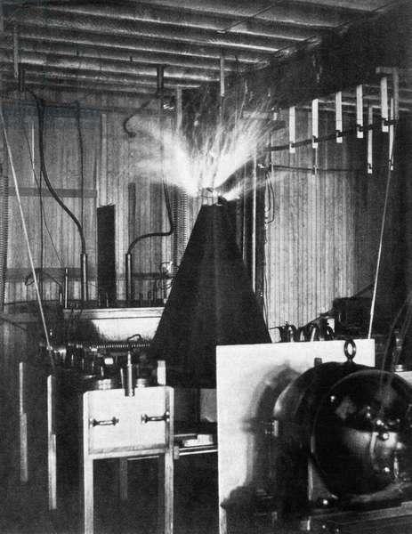 TESLA COIL, 1894 The Tesla coil in Nikola Tesla's laboratory in New York. Photograph, 1894.