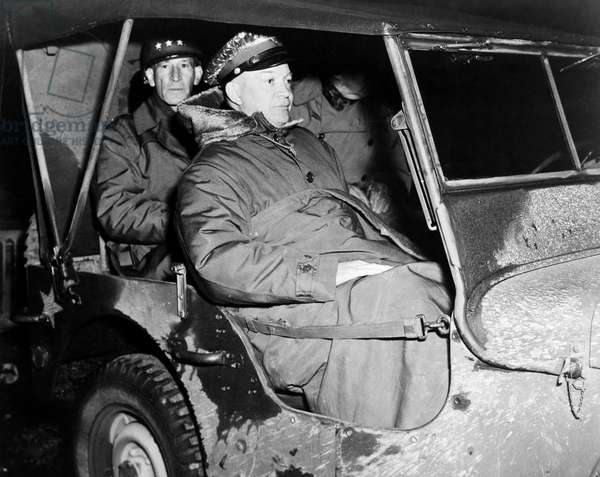 DWIGHT D. EISENHOWER (1890-1969). 34th President of the United States. General Eisenhower, with Lieutenant General Raymond Stallings McLain in the back seat, proceeds to the front in November, 1944.