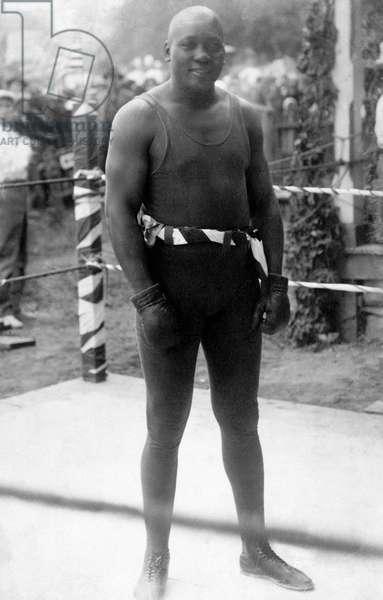 JACK JOHNSON (1878-1946) American heavyweight pugilist. Photographed while training, 1910-1915.