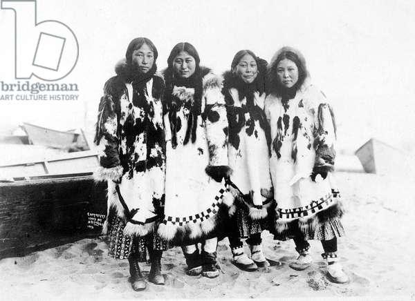 ESKIMO WOMEN in Alaska, c. 1903.