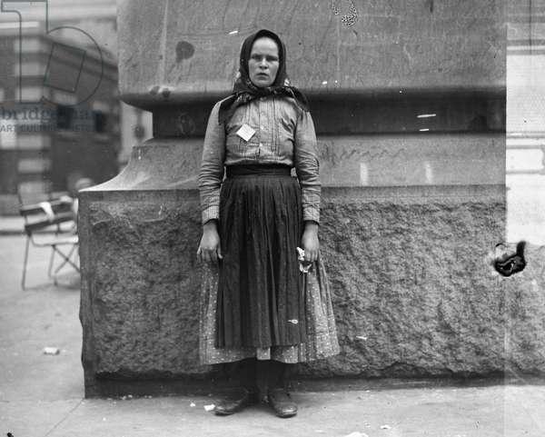 IMMIGRANTS: ELLIS ISLAND An unidentified immigrant woman at Ellis Island, New York City, c.1900.