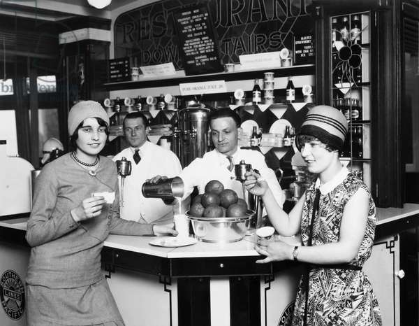 FLAPPERS, 1928 Two young women, on their way to San Francisco on an East Bay ferry, enjoying a refreshment, 1928.