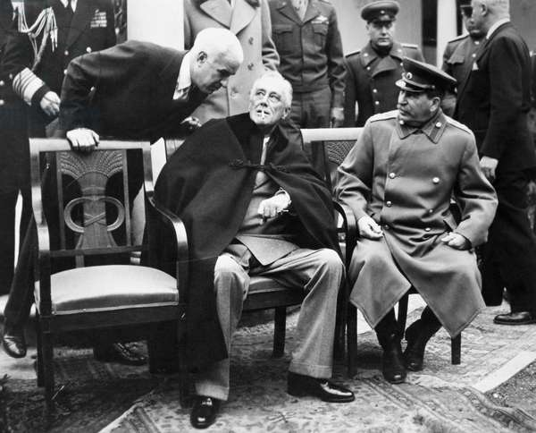YALTA CONFERENCE, 1945 U.S. Secretary of State Edward R. Stettinius (left), U.S. President Franklin D. Roosevelt (center), and Soviet Premier Joseph Stalin photographed on the patio at Livadia Palace, Yalta, Crimea, February 1945.