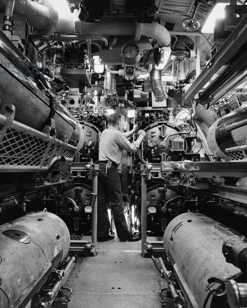 NAVY: USS NAUTILUS, 1958 A torpedoeman checking the torpedo tubes of the USS Nautilus during the voyage to the North Pole. Photograph, 1958.