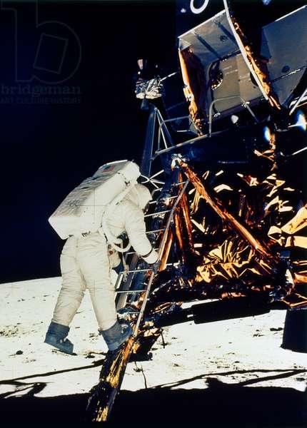 """APOLLO 11: 'BUZZ' ALDRIN descends lunar module, """"Eagle,"""" to the surface of the moon, 1969."""
