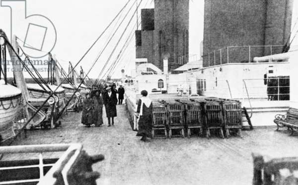 TITANIC: ON DECK, 1912 On deck in Cork Harbour; passing life boats in which survivors of the shipwreck subsequently escaped.