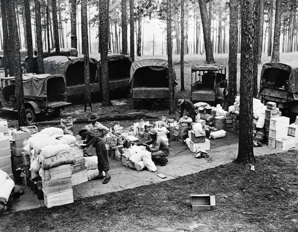 WWII: RATIONS, 1942 Food and supplies for troops of the Third United States Army during the Louisiana Maneuvers in Louisiana. Photograph, 1942.