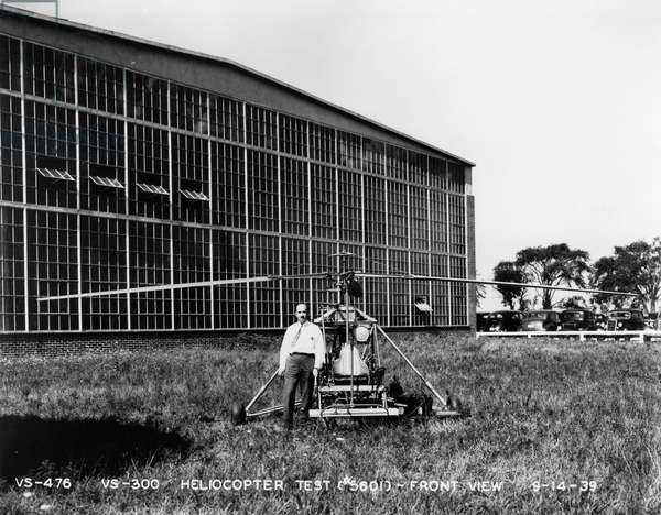 IGOR IVAN SIKORSKY (1889-1972). American (Ukrainian-born) aeronautical engineer. Sikorsky with his VS-300 helicopter before a test flight. Photograph, 14 September 1939.