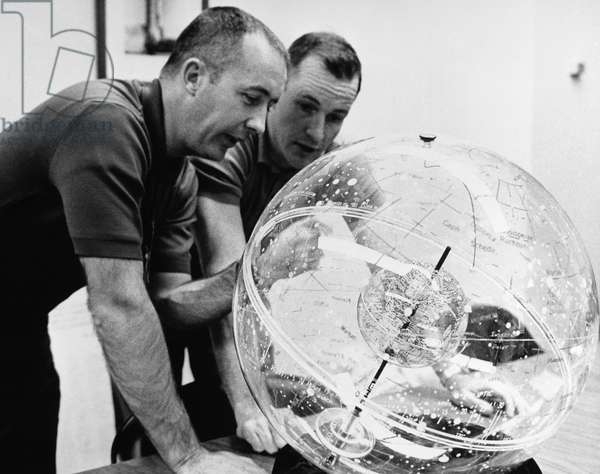 GEMINI IV ASTRONAUTS, 1965 Astronauts James McDivitt (left) and Edward White use a celestial navigation aid to study the locations of constellations and celestial bodies they expect to see during their upcoming Gemini IV space mission, 1965.