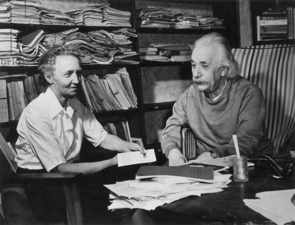 JOLIOT-CURIE/EINSTEIN Irene Joliot-Curie (1897-1956), French physicist, with Albert Einstein (1879-1955), American (German born) theoretical physicist, in the study of Einstein's home in Princeton, New Jersey.