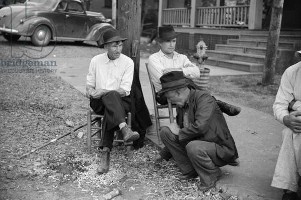 MINER STRIKE, 1939. Striking copper miners waiting for scabs to come out of the mines in Ducktown, Tennessee. Photograph by Marion Post Wolcott, September 1939.