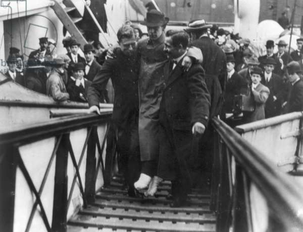 TITANIC: SURVIVOR, 1912 Harold Bride, a wireless operator aboard the 'Titanic,' being carried aboard the 'Carpathia.' Photographed 27 May 1912.