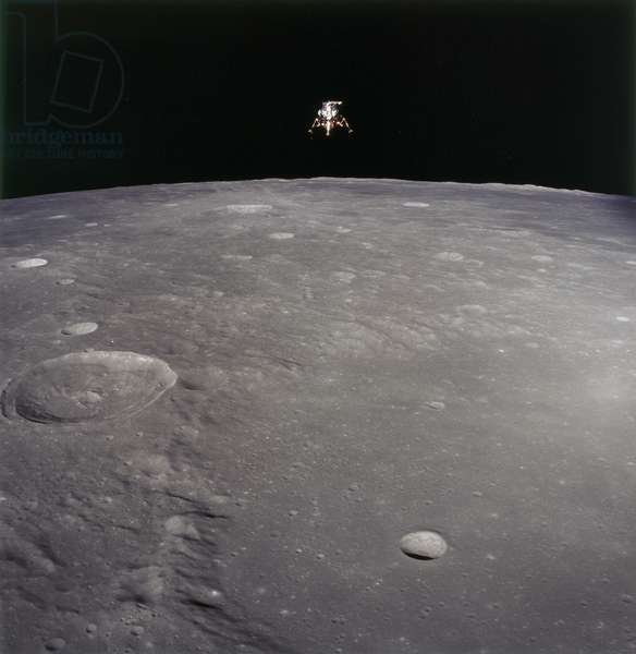 APOLLO 12, 1969 The Apollo 12 Lunar Module photographed in lunar orbit from the Command and Service Modules. The large crater in the forground in Ptolemaeus and the second largest is Herschel. Photograph, 19 November 1969.