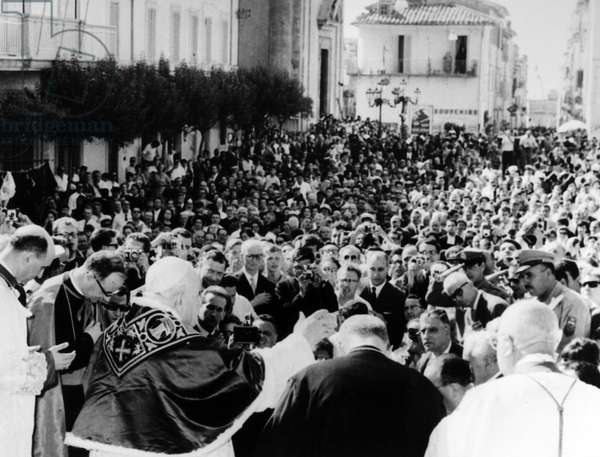 JOHN XXIII (1881-1963) Pope, 1958-1963. Pope John (left foreground) blessing the crowd in Castel Gandolfo, Italy, following a mass in observance of the Feast of the Assumption, 15 August 1962.