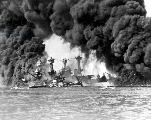 WORLD WAR II: PEARL HARBOR. The USS West Virginia and the USS Tennessee after the Japanese attack on Pearl Harbor, 7 December 1941.