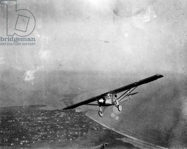 CHARLES A. LINDBERGH (1902-1974). American aviator. Lindbergh at the controls of the Spirit of St. Louis in flight, 1927.