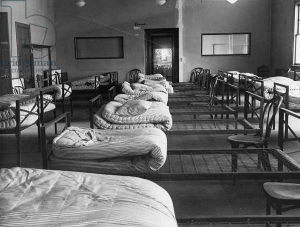 ELLIS ISLAND: DORMITORY Sleeping quarters for detained 'enemy alien' Italian seamen, held at Ellis Island during World War II. Photograph, c.1943.