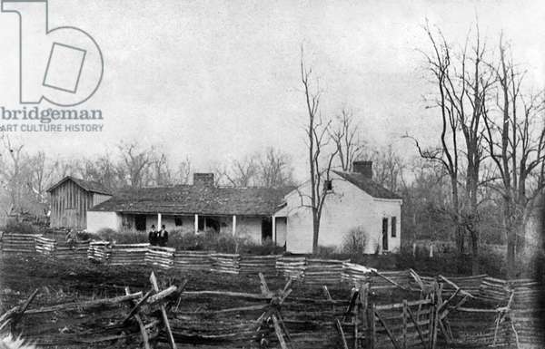 JESSE JAMES (1847-1882) Two men standing in front of the home of Jesse James. Photograph, 1877.