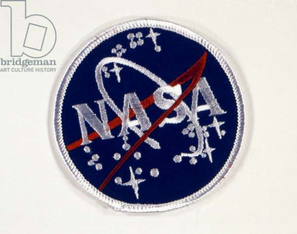 SPACE: INSIGNIA PATCH Embroidered patch of the official NASA insignia, 1959-1982 and 1992-present. Photograph, c.1970.