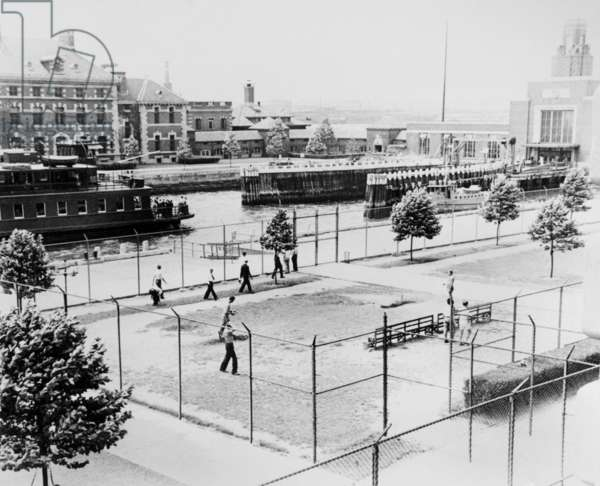 ELLIS ISLAND, c.1943 Men playing in the recreation fields on Ellis Island, when it served as a detention center for 'alien enemies' during World War II. Photograph, c.1943.