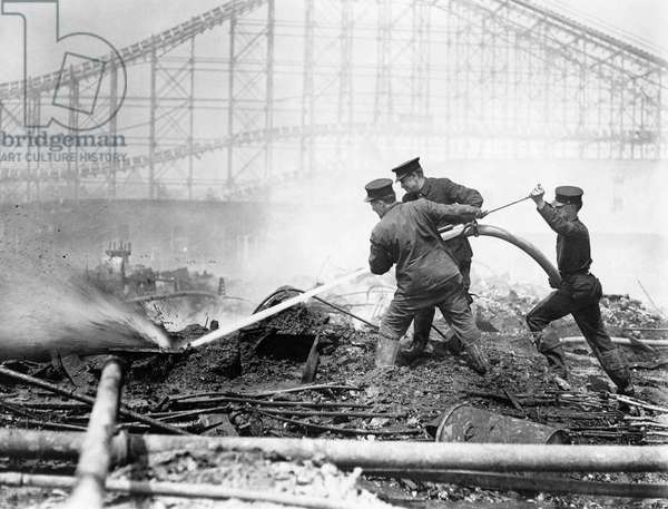 CONEY ISLAND: DREAMLAND Firefighters fighting the fire that destroyed Dreamland amusement park at Coney Island, Brooklyn, New York. Photograph, May 1911.