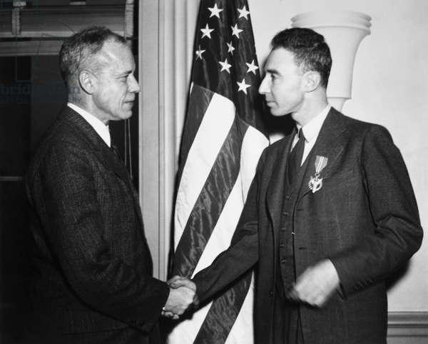J. ROBERT OPPENHEIMER (1904-1967). American physicist. Oppenheimer (left) receiving the Medal for Merit from the Secretary of War, Robert Patterson. Photograph, 5 March 1946.