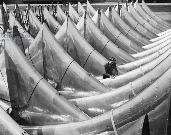 WORLD WAR II: AIRCRAFT Dorsal fins for Boeing B-29 superfortress bomber aircrafts in the Boeing plant at Renton, Washington, c.1944.