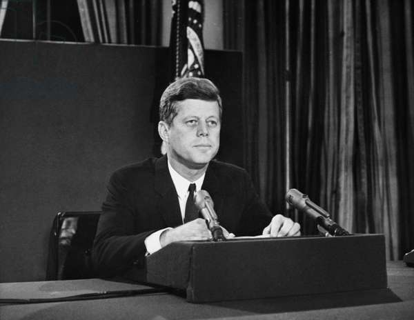 JOHN F. KENNEDY (1917-1963) 35th President of the United States. Announcing a U.S. naval blockade of Cuba to a nationwide television audience at the time of the Cuban Missile Crisis, 22 October 1962.