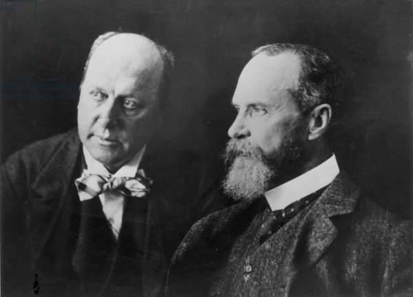 WILLIAM JAMES (1842-1910) American philosopher and psychologist. Photographed (at right) with his brother, novelist Henry James, c.1902.