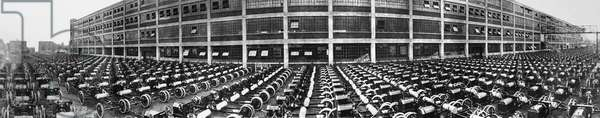 FORD AUTOMOBILE FACTORY Hundreds of incomplete Ford automobiles at an American factory. Photograph, early 20th century.