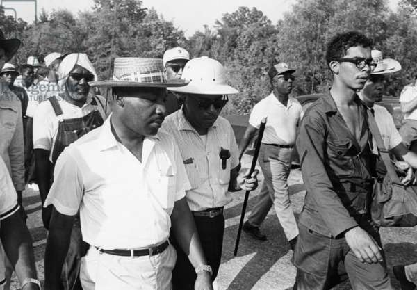 KING AND MEREDITH, 1966 James Meredith (with cane) and Martin Luther King, Jr., during the 'Freedom March' from Canton, Mississippi to the Tougaloo College campus, 25 June 1966.