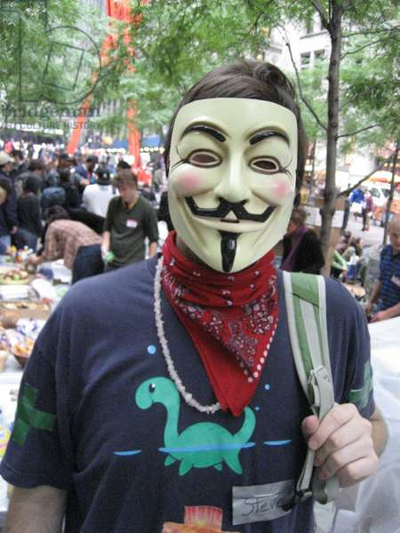 OCCUPY WALL STREET, 2011 A protester at the Occupy Wall Street encampment in Zuccotti Park, New York City, wearing a Guy Fawkes mask, made popular by the graphic novel 'V for Vendetta,' and which has become associated with various anti-establishment activist groups. Photograph, October 2011.