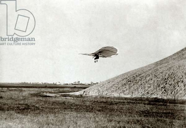 OTTO LILIENTHAL (1848-1896) German aeronautical engineer. One of Otto Lilenthal's early glider flights. Photograph, c.1895.