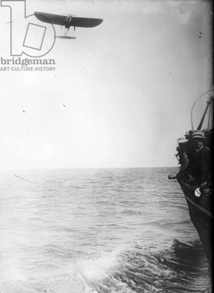 LOUIS BLERIOT (1872-1936) French engineer and pioneer aviator. Bleriot aloft in his monplane over the English Channel, 25 July 1909.