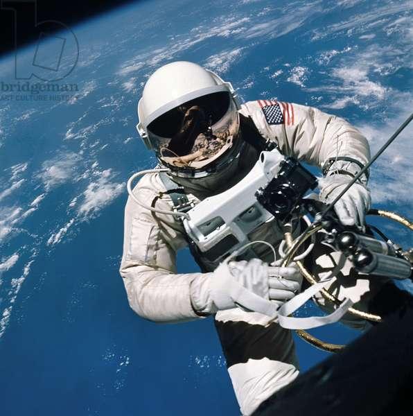 GEMINI 4: SPACEWALK, 1965 Astronaut Edward H. White performing the first spacewalk by an American astronaut. Photograph, 3 June 1965.