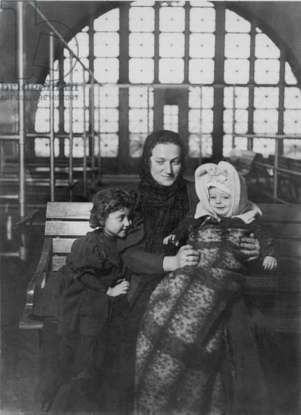 HINE: ELLIS ISLAND, 1905 An Italian mother with her children at Ellis Island. Photograph by Lewis W. Hine, 1905.