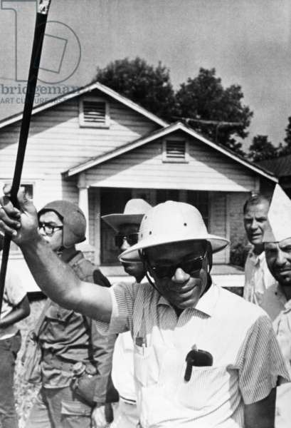 JAMES MEREDITH (1933- ) American civil rights leader. Meredith wearing a pith helmet and carrying an ebony cane, continuing his 'Freedom March' from Canton, Mississippi to the Tougaloo College campus on 25 June 1966, after recovering from an assassination attempt on 5 June.