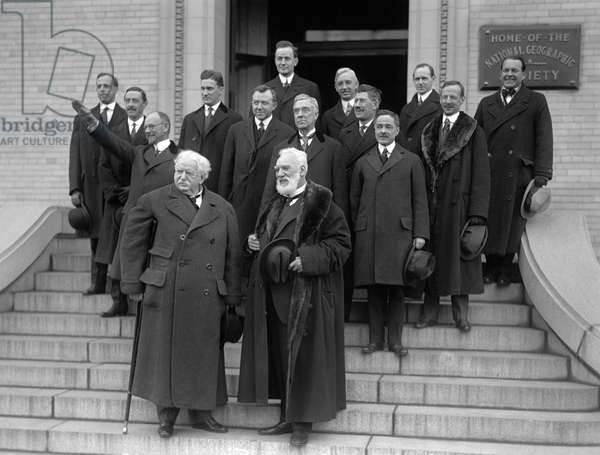 ALEXANDER GRAHAM BELL (1847-1922) American (Scottish-born) teacher and inventor. Photographed at the anniversary of Bell Telephone with the National Geographical Society. Front: Theodore N. Vail, Alexander Graham Bell, Back of Bell: Thomas A. Watson, Upward right: J.J. Carty, G.H Grosvenor and J.O. LaGorge. Photograph, 1916.