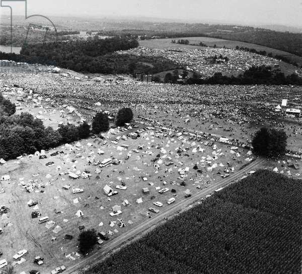 WOODSTOCK FESTIVAL, 1969 Aerial view of the Woodstock Music Festival at Bethel, Sullivan County, north of New York City, 16 August 1969. The bandstand can be seen at the upper center of the image. Photograph by Marty Lederhandler.