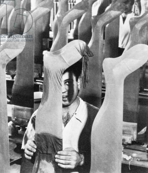 NYLON FACTORY, 1940s Worker at a nylon stocking factory, late 1940s.