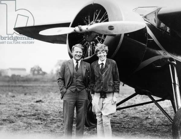 AMELIA EARHART (1897-1937) American aviator. Photograph with Bernt Blachen at Teterboro Airport in New Jersey, 1932.