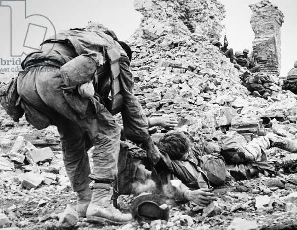 VIETNAM WAR: TET OFFENSIVE A U.S. Marine drags a wounded comrade from the ruins of the Citadel at Hue, South Vietnam, February 1968.