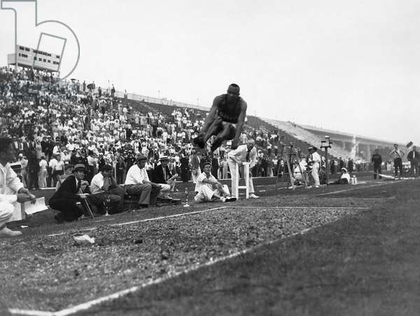 JAMES 'JESSE' OWENS (1913-1980). American athlete. Owens in the midst of his broad jump leap, which was responsible for one of the four gold medals he won and three track-and-field records he set at the 1936 Berlin Olympic Games.
